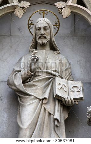 ZAGREB, CROATIA - SEPT 26: statue of Christ the Teacher on the portal of the cathedral dedicated to the Assumption of Mary and to kings Saint Stephen and Saint Ladislaus in Zagreb on Sept 26, 2013.
