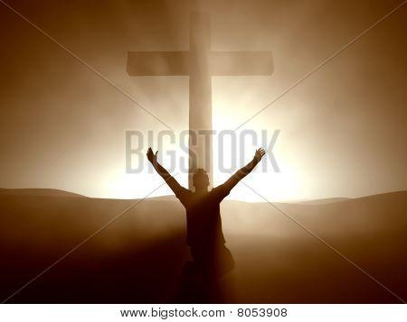 Man kneeling at the Cross of Jesus Christ