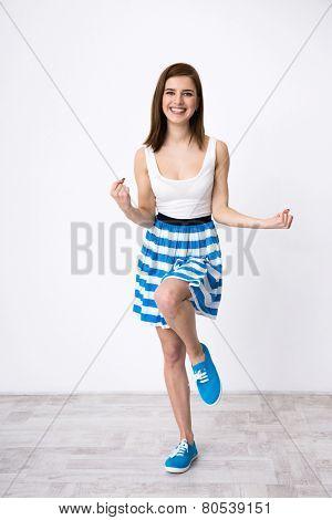 Portrait of a happy woman posing winning gesture