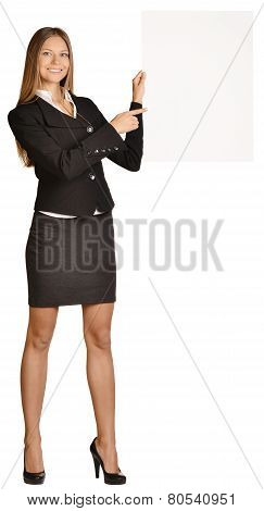 business woman holding a blank white board.