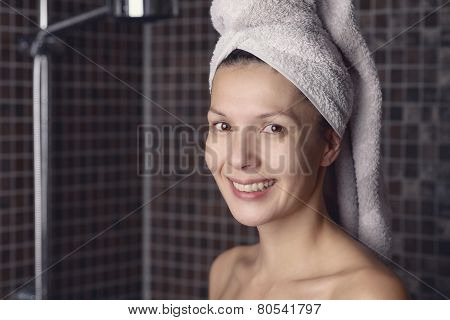 Happy Woman With Her Wet Hair In A Towel