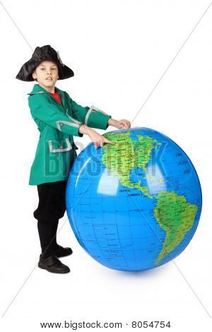 Little Boy In Historical Dress Standing With Big Inflatable Globe And Pointing By Finger