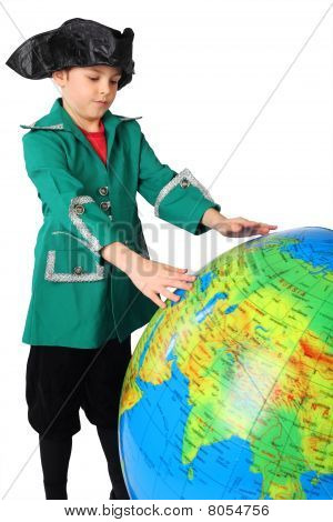 Little Boy In Historical Dress Looking At Big Inflatable Globe Isolated