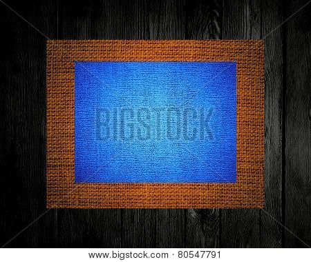 Burlap linen rustic canvas textured on dark wood background