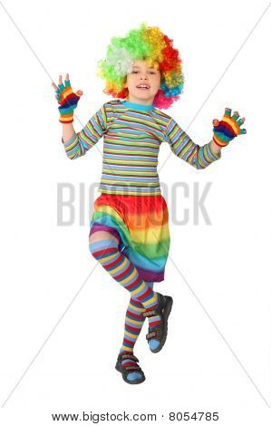 Little Boy In Clown Dress Standing On One Leg Isolated On White Background