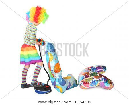 Boy In Clown Dress Pupming Birthday Balloons Isolated On White Background