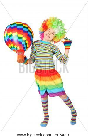 Boy In Clown Dress With Multicolored Hot-air Balloon Standing Isolated On White Background