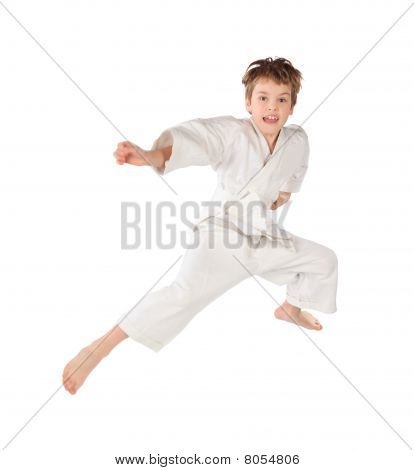Karateka Boy In White Kimono Jumping Isolated On White Background