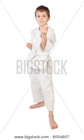 Karateka Boy In White Kimono Standing Isolated On White Background