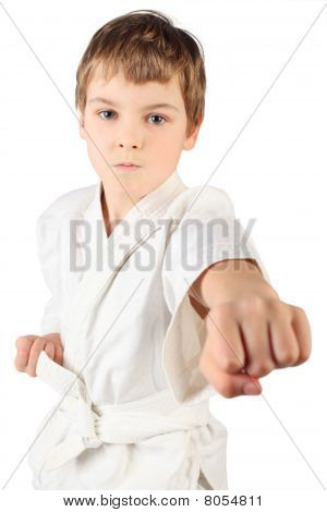 Karateka Boy In White Kimono Fighting Isolated On White Background
