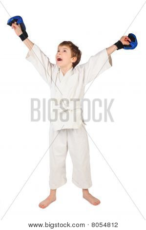 Little Boxer Boy In White Dress And Blue Boxing Gloves Hands Up Isolated On White