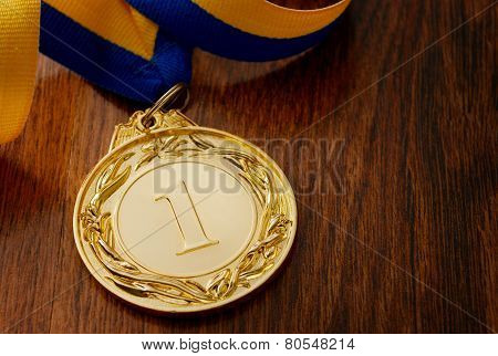Gold Medal On A Wooden Table