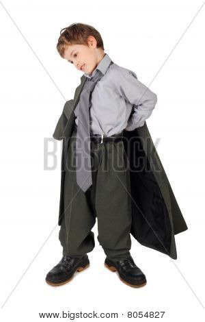 Little Boy In Big Grey Man's Suit And Boots Dressing Jacket Isolated On White Background