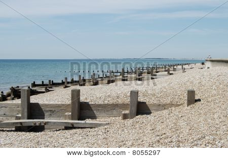 Wooden Groynes On Shingle Beach
