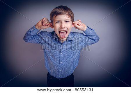 boy teenager European appearance brown grimaces experiencing joy