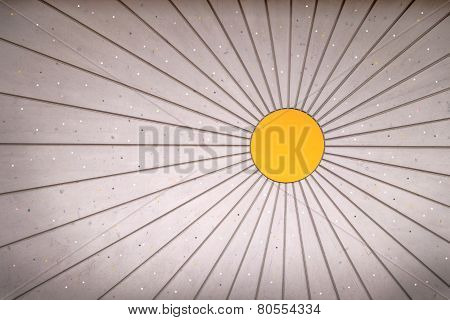 Sun-shaped wooden wall with small light points