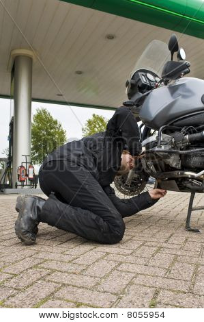 Motorist, Checking The Oil Level