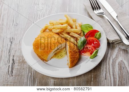 Chicken cutlets with butter on Kiev on a plate