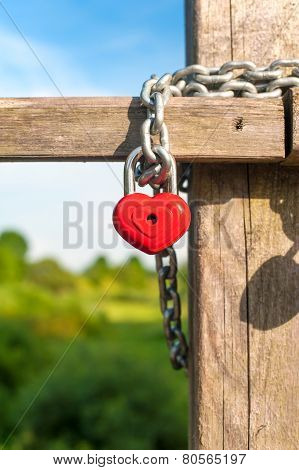 Love Heart Shape Lock With Chain On Wooden Bridge.