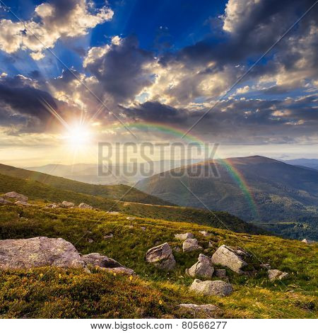 Mountain Hillside With White Boulders At Sunset