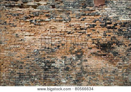 Damaged red brick wall texture