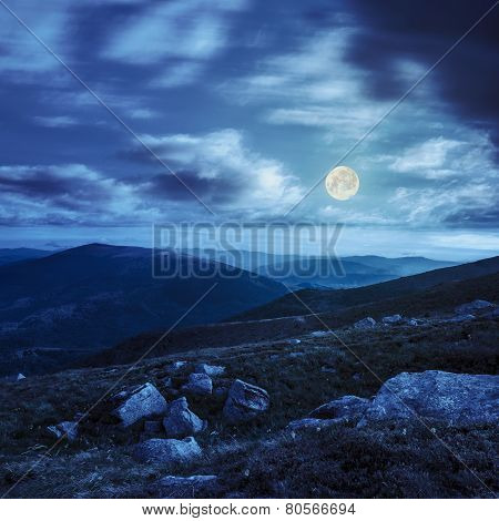 Mountain Hillside With White Boulders At Night