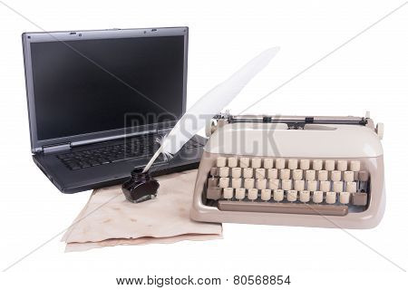 Black Laptop, Old Typewriter And Feather Pen Into The Inkwell