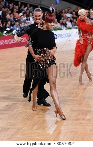 latin american couple dancing at the competition