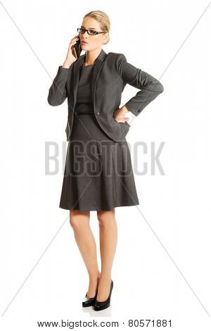 Business woman talking on her mobile phone.