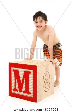 Boy In Swim Suit With Letter M