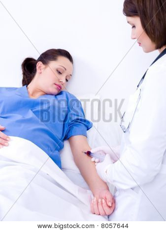 Doctor Takes Blood At The Pregnant Woman