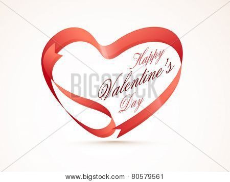 Creative heart shape made by glossy ribbon for Happy Valentines Day celebration.