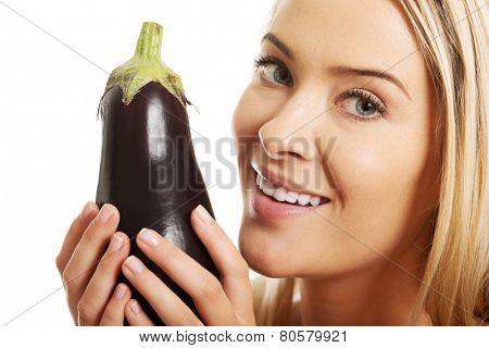 Portrait of a woman holding eggplant.