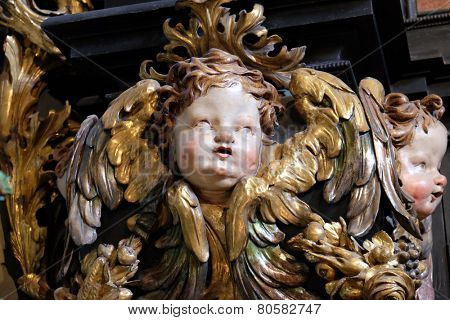 ST. WOLFGANG, AUSTRIA - DECEMBER 14: Angel on the altar of the Holy Rosary in Parish church in St. Wolfgang on Wolfgangsee in Austria on December 14, 2014.