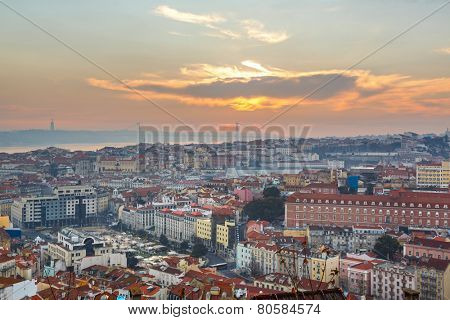 Portugal, Europe - Viewpoint to Lisbon downtown at sunset, with bridge over tagus river - HDR Composite