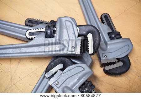 Tools set in vintage picture style . set of hand tools on a wooden background, Wrench tools