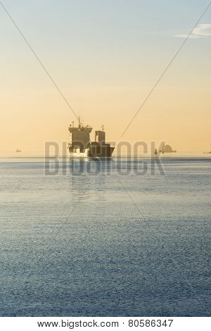 Cargo Ship At Sunset In The Oslo Bay