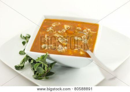 Hearty Manhattan Clam Chowder soup with fresh oregano