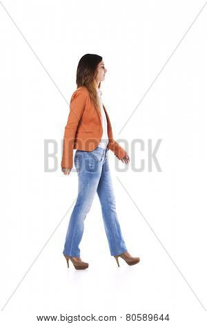Young businesswoman walking isolated on white