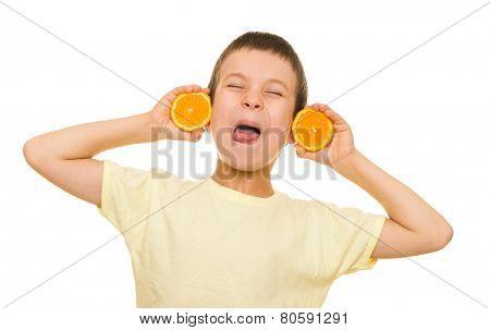 boy with sliced oranges having fun