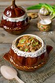image of pot roast  - Buckwheat with meat in a pot on the wooden table - JPG
