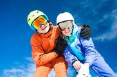 stock photo of family ski vacation  - skiing and snowboarding - JPG