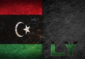 image of libya  - Old rusty metal sign with a flag and country abbreviation  - JPG
