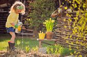 image of pot plant  - cute child girl in yellow cardigan - JPG