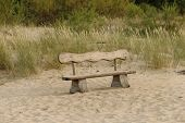 foto of dune grass  - Bench in sand beach dunes in green grass  - JPG