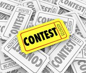 image of prize  - Contest word on tickets in a pile to illustrate the winning ticket drawn and prize awarded to lucky person or player - JPG