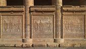 foto of hieroglyph  - Hieroglyphic carvings on the exterior walls of an ancient egyptian temple  - JPG