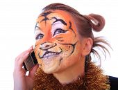 foto of tigers  - Girl a tiger speaks on a mobile telephone - JPG
