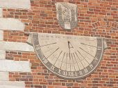 foto of sundial  - Ancient sundial on a building wall in Krakow - JPG