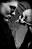 foto of hamlet  - A young man dressed in black with a skull in his hands - JPG